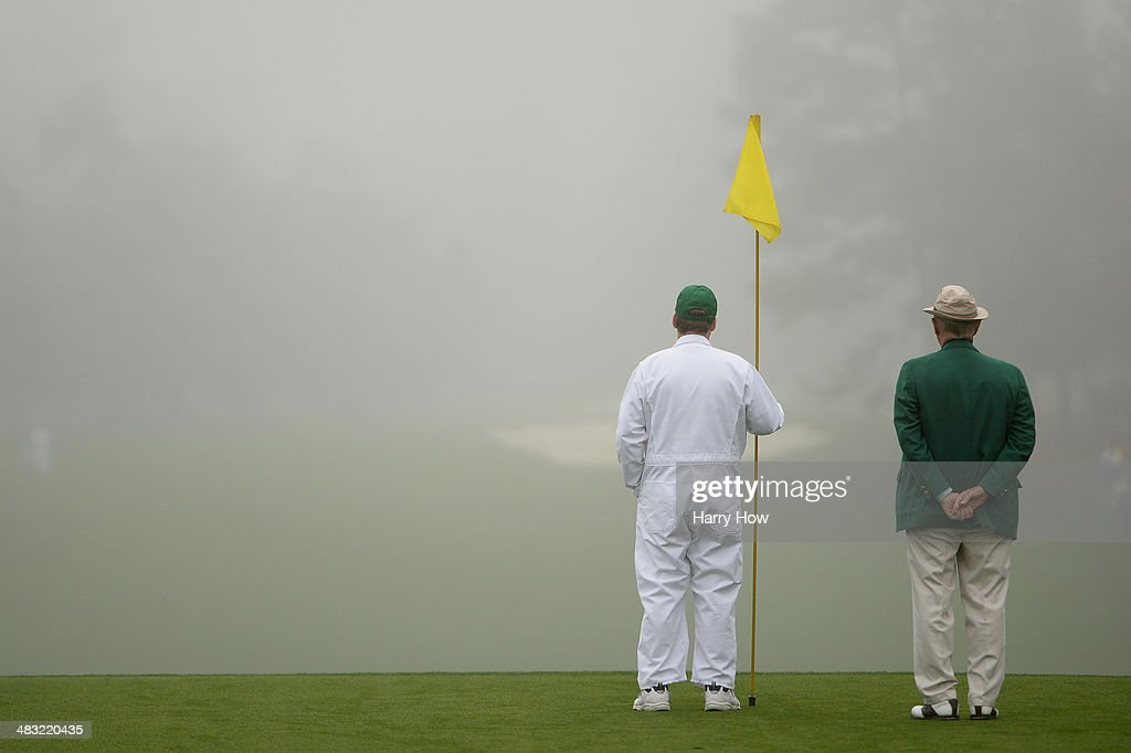 A caddie holds a flag pin during a practice round prior to the start of the 2014 Masters Tournament at Augusta National Golf Club on April 7, 2014 in Augusta, Georgia.