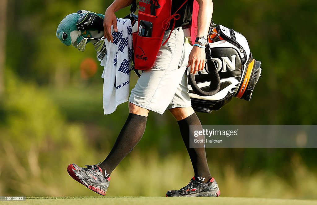 A caddie is seen during crazy sock day in the third round of the Shell Houston Open at the Redstone Golf Club on March 30, 2013 in Humble, Texas.