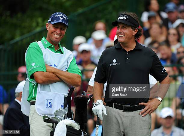 Caddie Jim ''Bones'' MacKay and Phil Mickelson are seen on the first hole during the second round of the Deutsche Bank Championship at TPC Boston on...