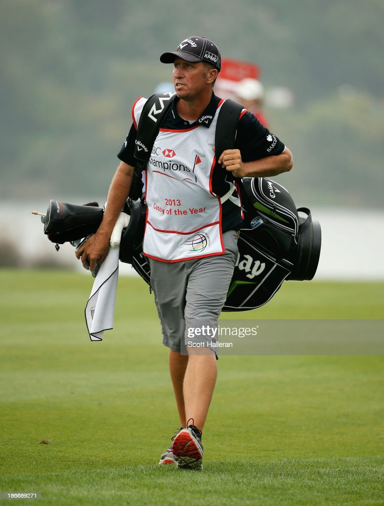 Caddie Jim Mackay walks on the 18th hole during the final round of the WGC-HSBC Champions at the Sheshan International Golf Club on November 3, 2013 in Shanghai, China.