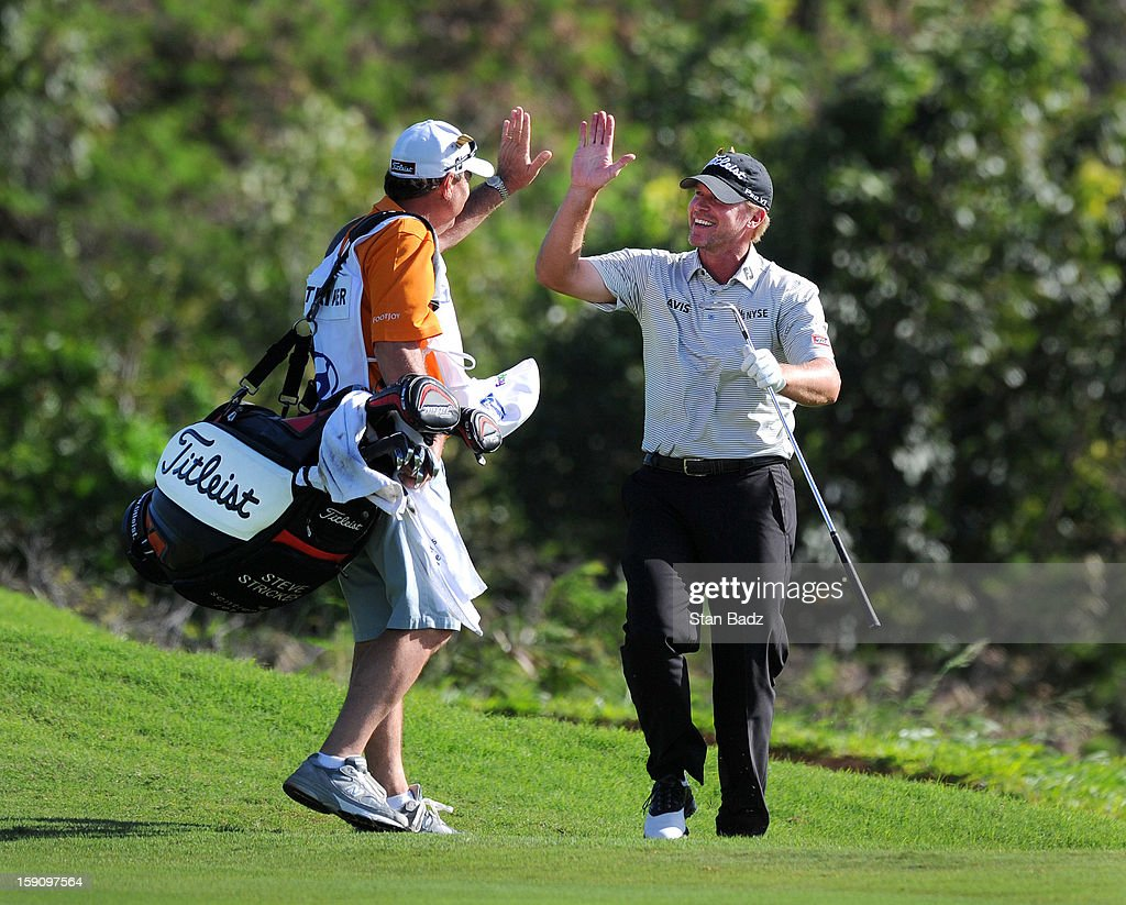 Caddie Jimmy Johnson and <a gi-track='captionPersonalityLinkClicked' href=/galleries/search?phrase=Steve+Stricker&family=editorial&specificpeople=239196 ng-click='$event.stopPropagation()'>Steve Stricker</a> celebrates Stricker's eagle chip on the 18th hole during the second round of the Hyundai Tournament of Champions at Plantation Course at Kapalua on January 7, 2013 in Kapalua, Maui, Hawaii.