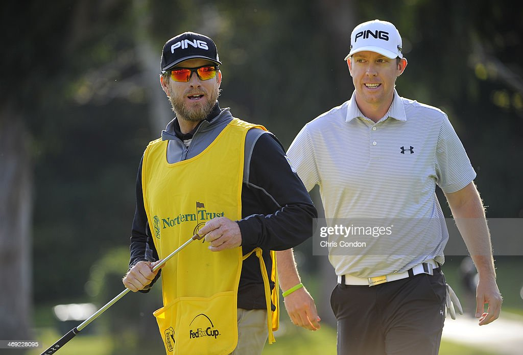 Caddie John Wood and Hunter Mahan walk off the 16th tee during the first round of the Northern Trust Open at Riviera Country Club on February 13 2014...