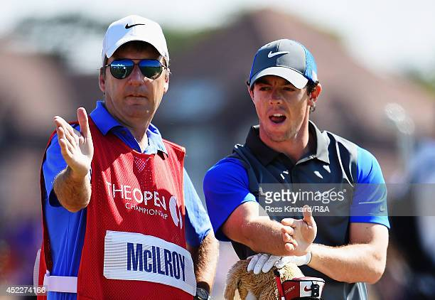 Caddie JP Fitzgerald talks with Rory McIlroy of Northern Ireland during the first round of The 143rd Open Championship at Royal Liverpool on July 17...