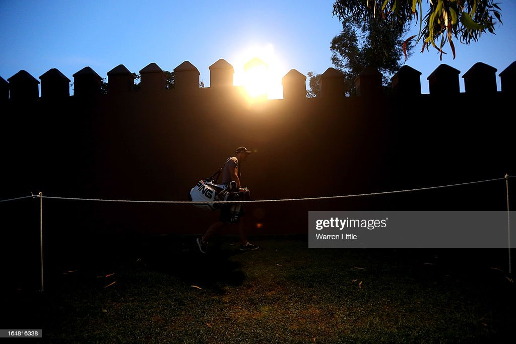 A caddie leaves the ninth green during the first round of the Trophee du Hassan II Golf at Golf du Palais Royal on March 28, 2013 in Agadir, Morocco.