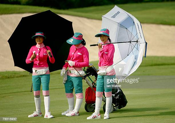 Caddies look on during the PROAM of the 2007 Enjoy Jakarta Astro Indonesian Open at Damai Indah Golf and Country Club on February 14 2007 in Jakarta...