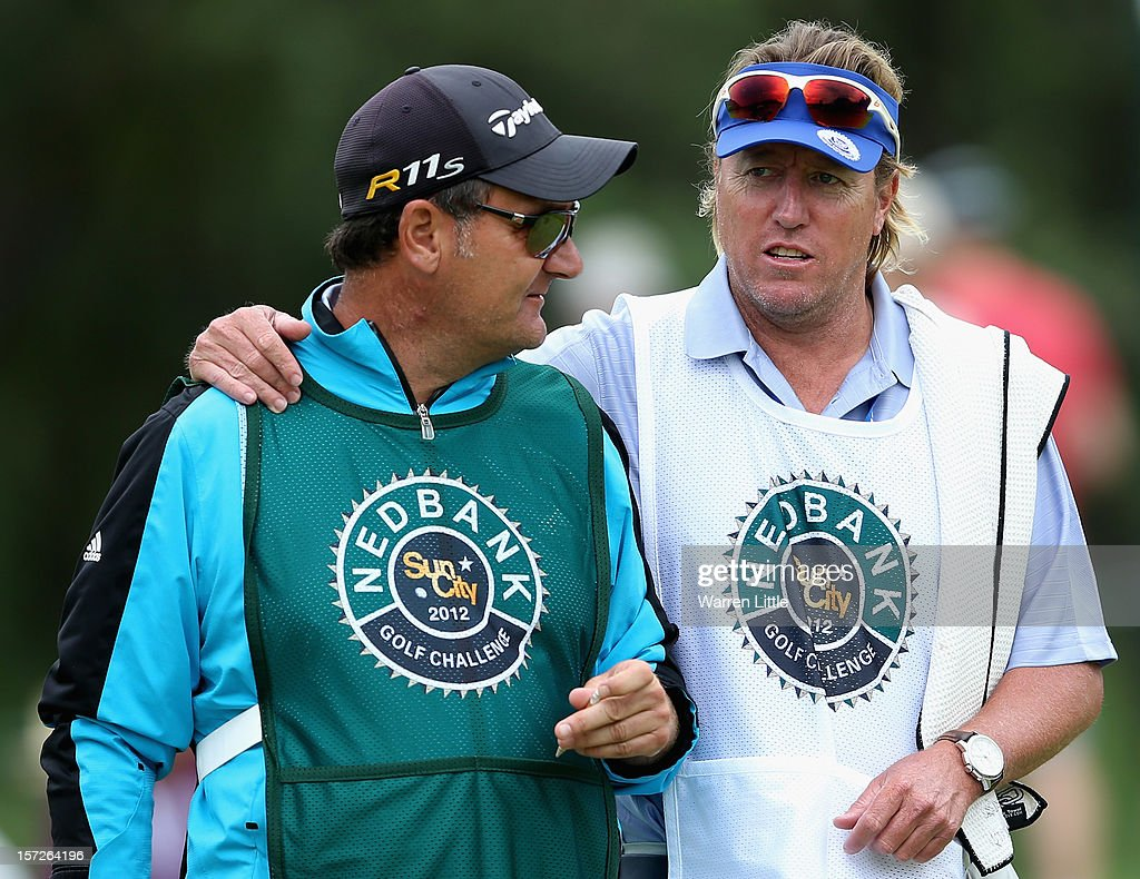 Caddies Mark Fulcher and Brian Nilsson have a chat during the third round of the Nedbank Golf Challenge at the Gary Player Country Club on December 1, 2012 in Sun City, South Africa.