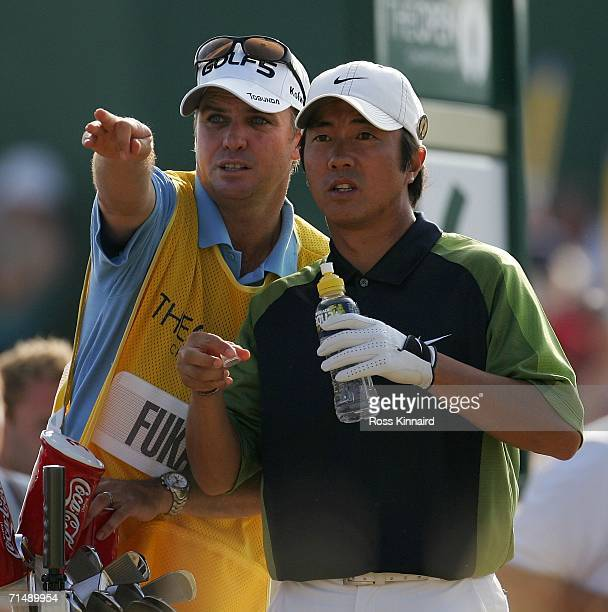 Caddy Simon Clarke discusses the line of a shot with Keiichiro Fukabori of Japan during the first round of The Open Championship at Royal Liverpool...