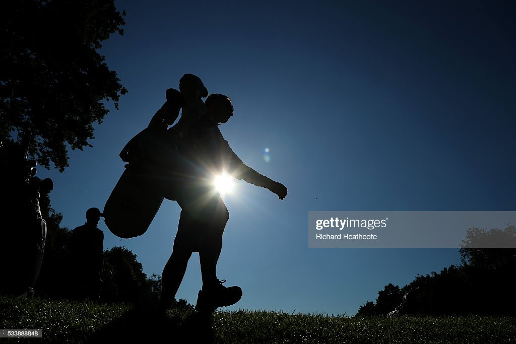 A caddy walks off a tee box during a practise round for the BMW PGA Championship at Wentworth on May 24, 2016 in Virginia Water, England.