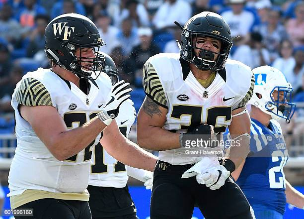 Cade Carney of the Wake Forest Demon Deacons reacts after scoring his first career touchdowen against the Duke Blue Devils during their game at...