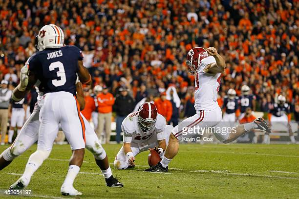 Cade Foster of the Alabama Crimson Tide kicks a field goal attempt that is blocked in the fourth quarter against the Auburn Tigers at JordanHare...