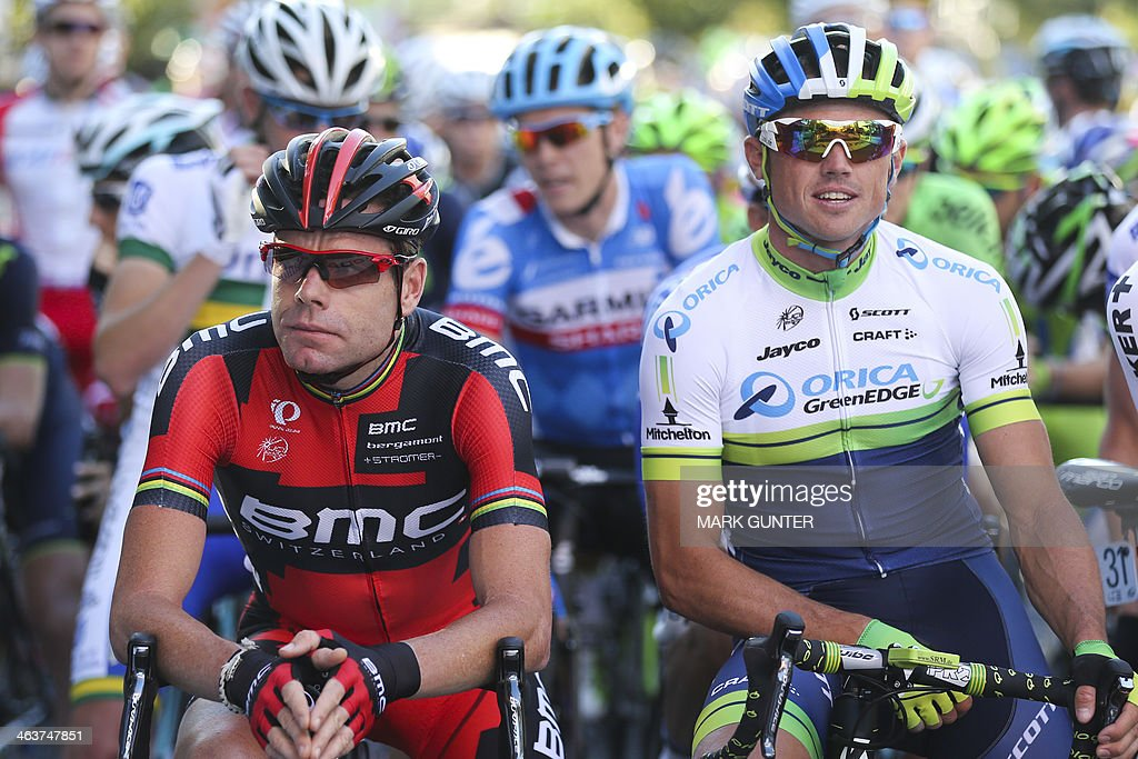 Cadel Evan (L) from Australia and Simon Gerrans (R) before the Peoples Choice Classic held prior to the Tour Down Under cycling race in Adelaide on January 19, 2014. AFP PHOTO / Mark Gunter USE
