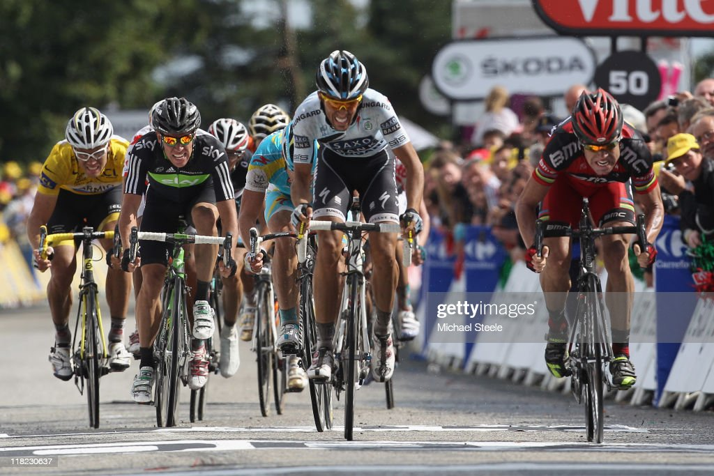 <a gi-track='captionPersonalityLinkClicked' href=/galleries/search?phrase=Cadel+Evans&family=editorial&specificpeople=661127 ng-click='$event.stopPropagation()'>Cadel Evans</a> (R) of Australia and BMC Racing team battles to victory alongside <a gi-track='captionPersonalityLinkClicked' href=/galleries/search?phrase=Alberto+Contador&family=editorial&specificpeople=562697 ng-click='$event.stopPropagation()'>Alberto Contador</a> (C) of Spain and team Saxobank Sungard during Stage 4 of the 2011 Tour de France from Lorient to Mur de Bretagne on on July 5, 2011 in Bretagne, France.