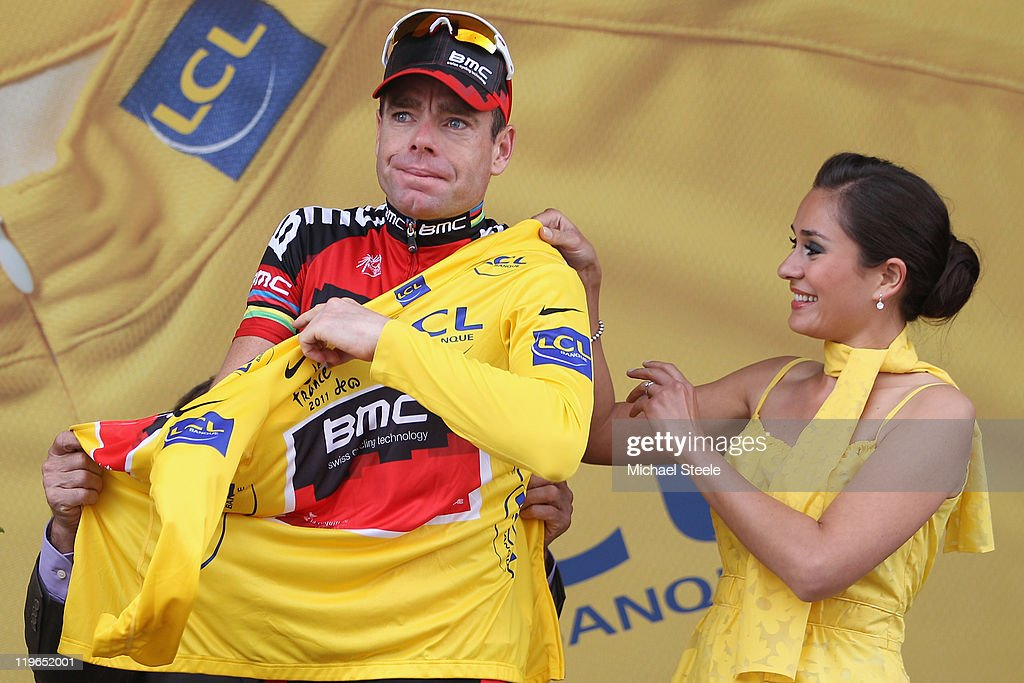 <a gi-track='captionPersonalityLinkClicked' href=/galleries/search?phrase=Cadel+Evans&family=editorial&specificpeople=661127 ng-click='$event.stopPropagation()'>Cadel Evans</a> of Australia and BMC Racing Team becomes the race leaders yellow jersey after the Individual Time Trial Stage 20 of the 2011 Tour de France on July 23, 2011 in Grenoble, France.