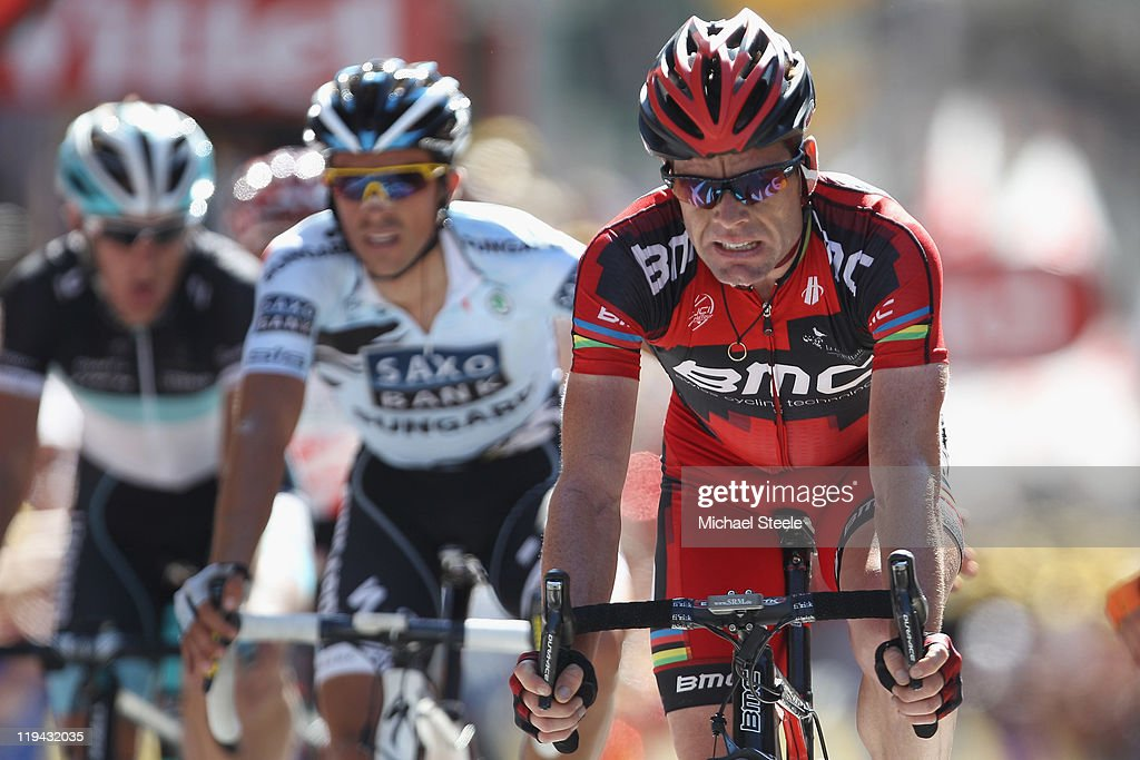 <a gi-track='captionPersonalityLinkClicked' href=/galleries/search?phrase=Cadel+Evans&family=editorial&specificpeople=661127 ng-click='$event.stopPropagation()'>Cadel Evans</a> (R) of Australia and BMC Racing Team crosses the finishing line alongside <a gi-track='captionPersonalityLinkClicked' href=/galleries/search?phrase=Alberto+Contador&family=editorial&specificpeople=562697 ng-click='$event.stopPropagation()'>Alberto Contador</a> (C) of Spain and Saxo Bank Sungard and <a gi-track='captionPersonalityLinkClicked' href=/galleries/search?phrase=Andy+Schleck&family=editorial&specificpeople=768445 ng-click='$event.stopPropagation()'>Andy Schleck</a> (L) of Luxemburg and Team Leopard-Trek during Stage 17 of the 2011 Tour de France from Gap to Pinerolo on July 20, 2011 in Pinerolo, Italy.