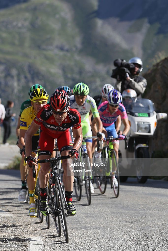 Cadel Evans of Australia and BMC Racing Team leads the chasing bunch ahead of yellow jersey leader Thomas Voeckler of France and Team Europcar on the...