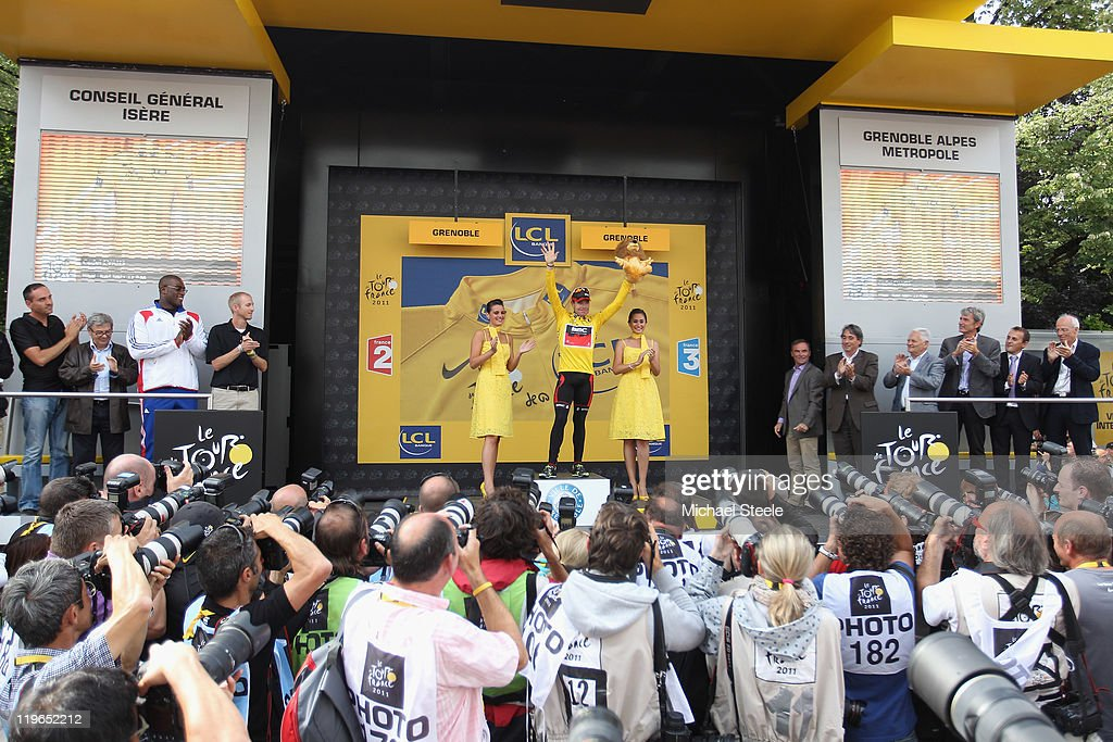 Cadel Evans of Australia and BMC Racing Team receives the applause of the crowd on the podium after becoming the race leaders yellow jersey after the Individual Time Trial Stage 20 of the 2011 Tour de France on July 23, 2011 in Grenoble, France.