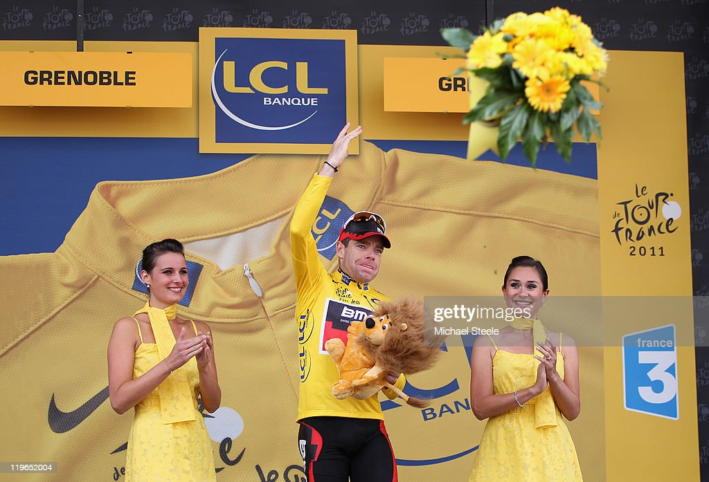<a gi-track='captionPersonalityLinkClicked' href=/galleries/search?phrase=Cadel+Evans&family=editorial&specificpeople=661127 ng-click='$event.stopPropagation()'>Cadel Evans</a> of Australia and BMC Racing Team throws a bouquet of flowers into the crowd after becoming the race leaders yellow jersey after the Individual Time Trial Stage 20 of the 2011 Tour de France on July 23, 2011 in Grenoble, France.
