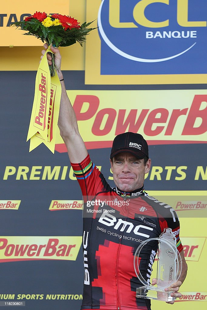 <a gi-track='captionPersonalityLinkClicked' href=/galleries/search?phrase=Cadel+Evans&family=editorial&specificpeople=661127 ng-click='$event.stopPropagation()'>Cadel Evans</a> of Australia and team BMC Racing receives the stage winners trophy after Stage 4 of the 2011 Tour de France from Lorient to Mur de Bretagne on on July 5, 2011 in Bretagne, France.