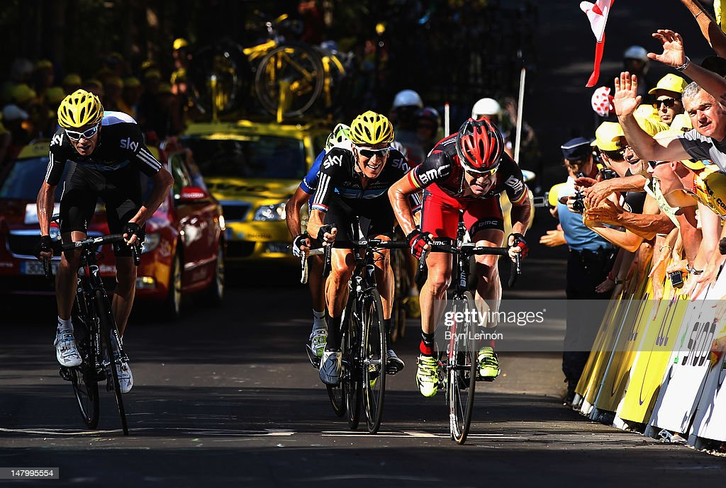 Cadel Evans of Australia and the BMC Racing Team leads Bradley Wiggins of Great Britain and SKY Procycling and Chris Froome of Great Britain and SKY...