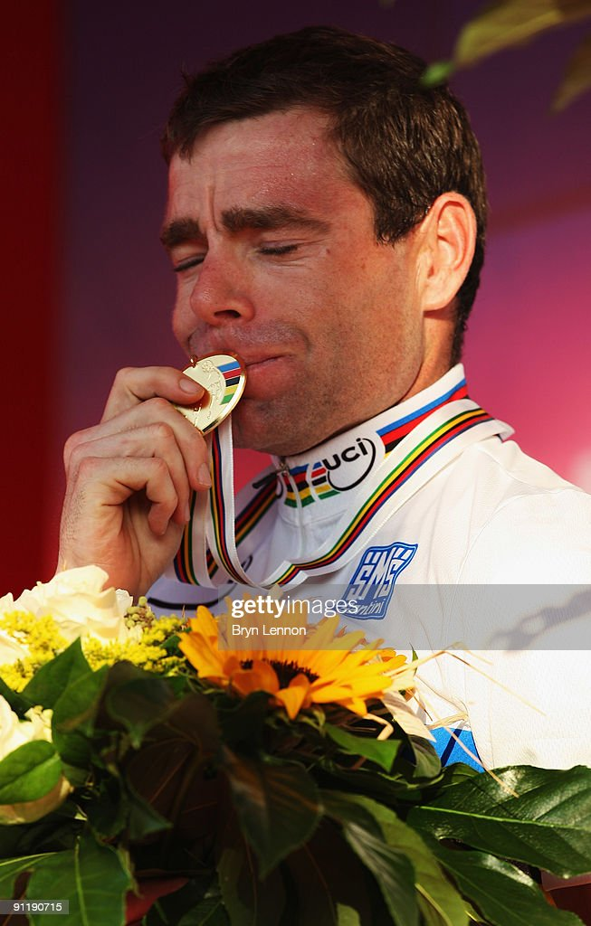 Cadel Evans of Australia kisses his gold medal after winning the Men's Road Race at the 2009 UCI Road World Championships on September 27, 2009 in Mendrisio, Switzerland.