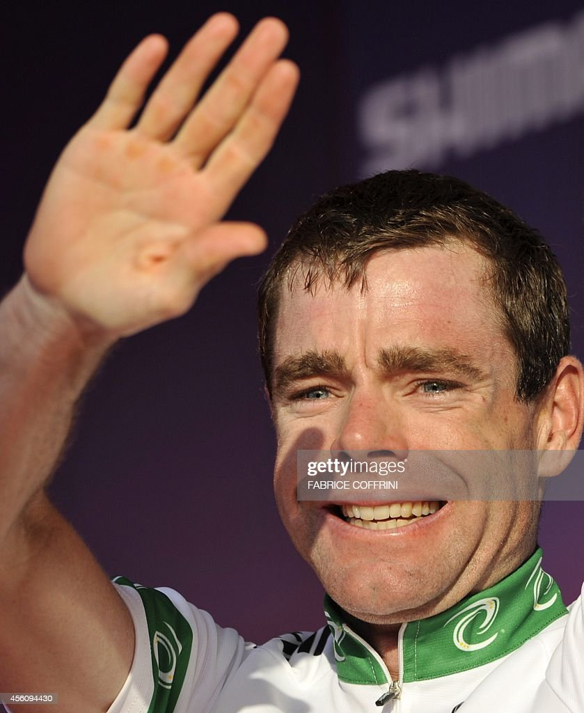 Cadel Evans of Australia reacts on the podium after winning the elite men's road race of the UCI cycling road World Championships on September 27...
