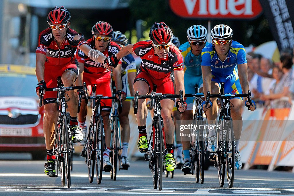 <a gi-track='captionPersonalityLinkClicked' href=/galleries/search?phrase=Cadel+Evans&family=editorial&specificpeople=661127 ng-click='$event.stopPropagation()'>Cadel Evans</a> (C) of Australia riding for BMC Racing crosses the finish line in hand with teammate <a gi-track='captionPersonalityLinkClicked' href=/galleries/search?phrase=George+Hincapie&family=editorial&specificpeople=534468 ng-click='$event.stopPropagation()'>George Hincapie</a> (L) of the USA in 35th and 36th place ahead of Andriy Grivko (R) of the Ukraine riding for Astana Pro Team in 37th place during stage sixteen of the 2012 Tour de France from Pau to Bagneres-de-Luchon on July 18, 2012 in Bagneres-de-Luchon, France. Evans dropped to seventh place in the general classification with the result.