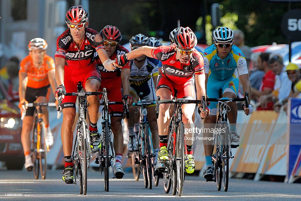 Cadel Evans (R) of Australia riding for BMC Racing crosses the finish line in hand with teammate George Hincapie (L) of the USA in 35th and 36th place during stage sixteen of the 2012 Tour de France from Pau to Bagneres-de-Luchon on July 18, 2012 in Bagneres-de-Luchon, France. Evans dropped to seventh place in the general classification with the result.