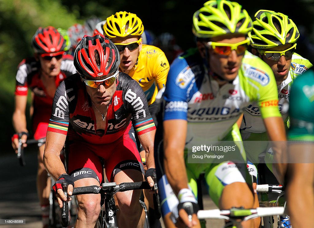 <a gi-track='captionPersonalityLinkClicked' href=/galleries/search?phrase=Cadel+Evans&family=editorial&specificpeople=661127 ng-click='$event.stopPropagation()'>Cadel Evans</a> (L) of Australia riding for BMC Racing is followed by <a gi-track='captionPersonalityLinkClicked' href=/galleries/search?phrase=Bradley+Wiggins&family=editorial&specificpeople=182490 ng-click='$event.stopPropagation()'>Bradley Wiggins</a> (C) of Great Britain riding for Sky Procycling in the race leader's yellow jersey on the climb of the Col de la Croix during stage eight of the 2012 Tour de France from Belfort, France to Porrentruy, Switzerland on July 8, 2012 in Saint-Ursanne, Switzerland.