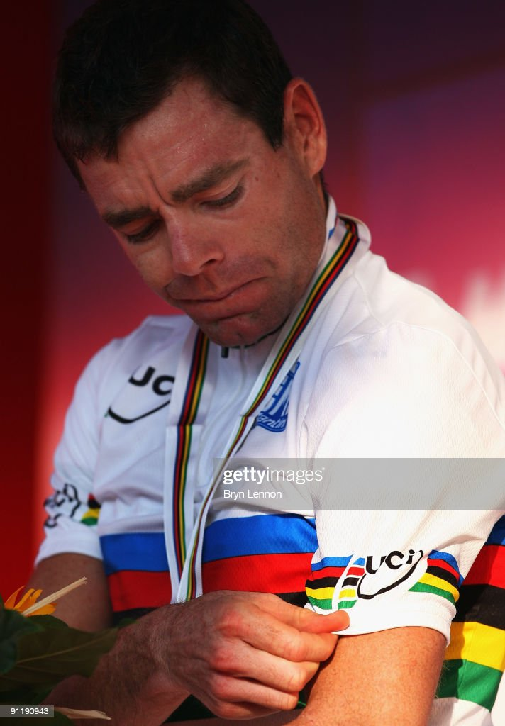 Cadel Evans of Australia straightens his World Champion's rainbow jersey after winning the Men's Road Race at the 2009 UCI Road World Championships...