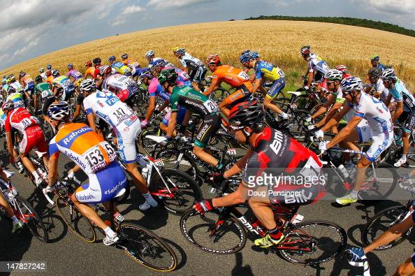 Cadel Evans of the USA riding for BMC Racing rides in the peloton as they pass thtough the countryside at the begining of stage four of the 2012 Tour...