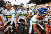 Cadel Evans Stuart O'Grady and Allan Davis of Australia wait for the start of the Men's Road Race at the 2009 UCI Road World Championships on...