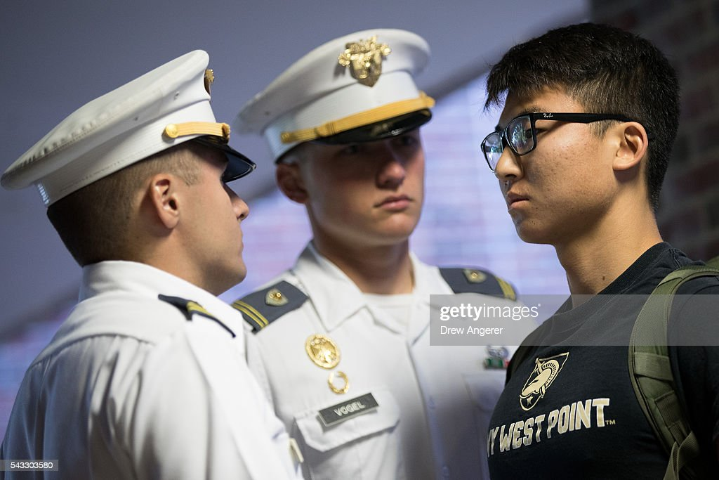 A cadet candidate (R) receives orders from older cadets during the in-processing procedures during Reception Day at the United States Military Academy at West Point, June 27, 2016 in West Point, New York. Reception Day is the day when new cadets report to West Point to begin the process of becoming West Point cadets and future U.S. Army officers. Upwards of 1,300 cadet candidates for the class of 2020 will report to West Point on Monday. The new cadets will begin six weeks of basic training before Acceptance Day in early August.