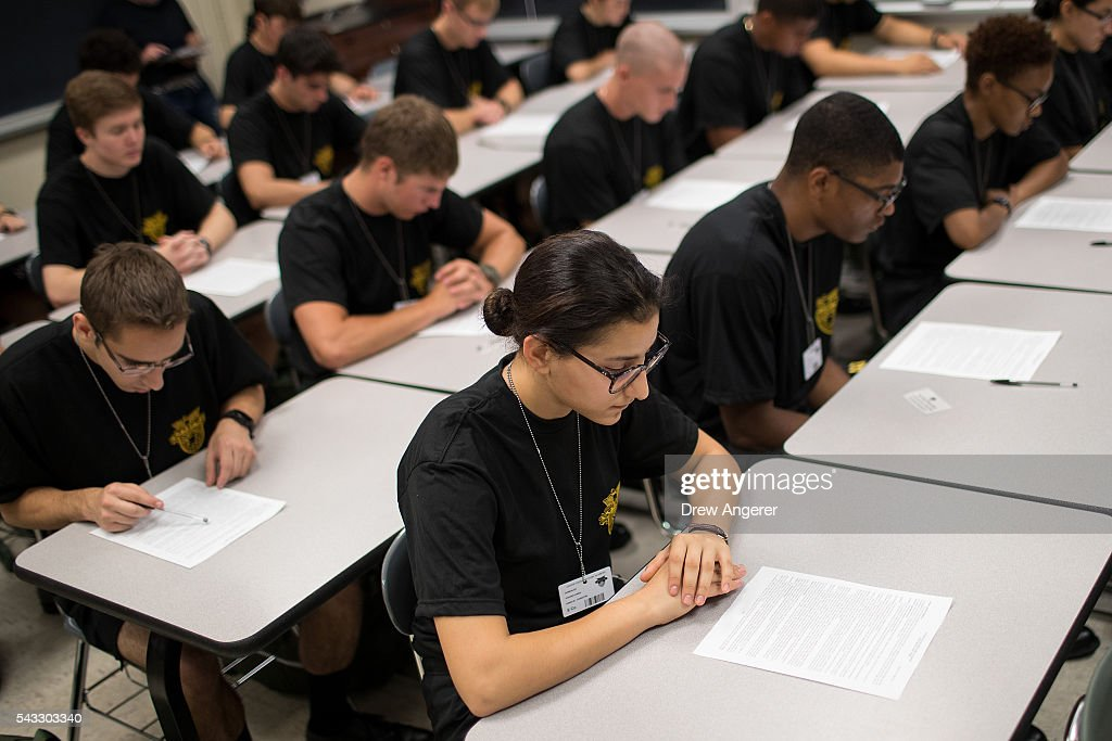 Cadet candidates read over their Oath of Allegiance paperwork during the in-processing procedures during Reception Day at the United States Military Academy at West Point, June 27, 2016 in West Point, New York. Reception Day is the day when new cadets report to West Point to begin the process of becoming West Point cadets and future U.S. Army officers. Upwards of 1,300 cadet candidates for the class of 2020 will report to West Point on Monday. The new cadets will begin six weeks of basic training before Acceptance Day in early August.