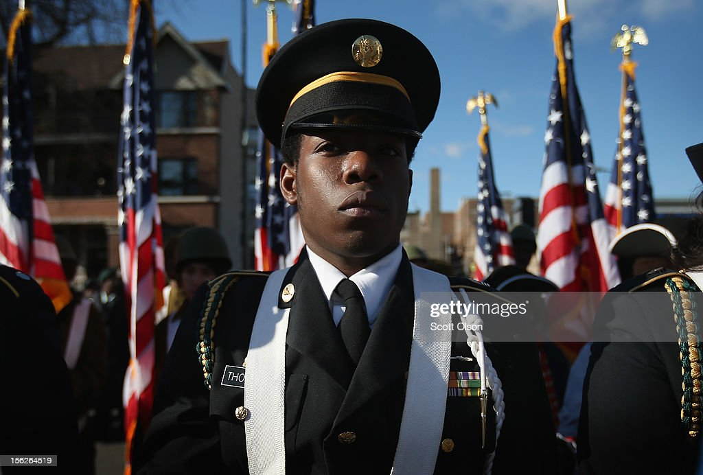 Cadet Command SGT MAJ Jermaine Wimpie and other students from the Chicago Military Academy participate in the Chicago Veterans Day parade on November 12, 2012 in Chicago, Illinois. Veterans Day, held the anniversary of the signing of the armistice which ended the World War I, is celebrated to honor all veterans for their service.