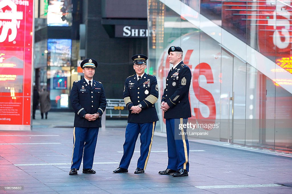 Cadet Ryan Cho, Sergeant First Class Johann Chiu and First Sergeant Eric Hunt attend 2012 Kisses For The Troops at Times Square on November 12, 2012 in New York City.