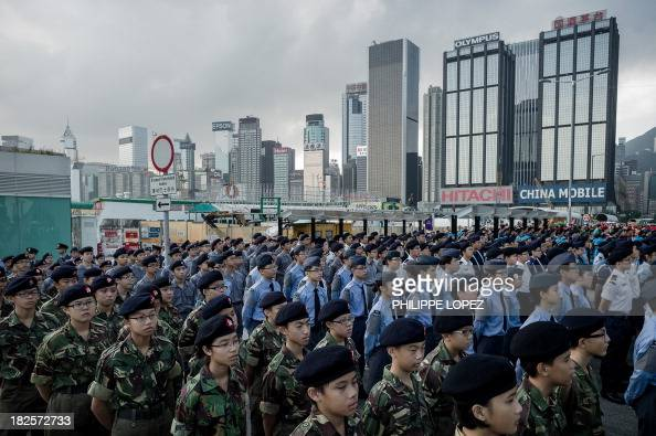 Cadets are lined up at a flagraising ceremony for the celebrations of China's national day in Hong Kong on October 1 2013 Hong Kong marked the 64th...