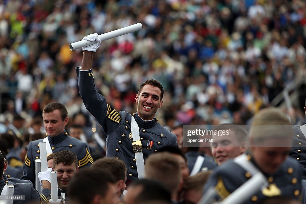 Cadets celebrate after tossing their hats in the air the conclusion of the graduation ceremony at the US Military Academy at West Point on May 28...