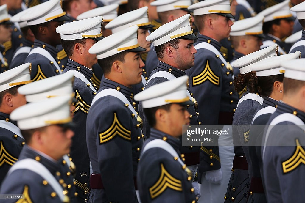 Cadets enter the stadium at West Point for the graduation ceremony at the US Military Academy on May 28 2014 in West Point New York US President...