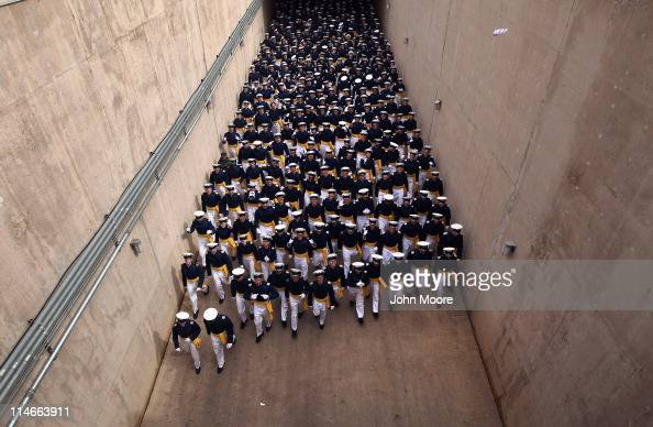 Cadets from the 2011 graduating class of the US Air Force Academy arrive to Falcon Stadium on May 25 2011 in Colorado Springs Colorado A total of...