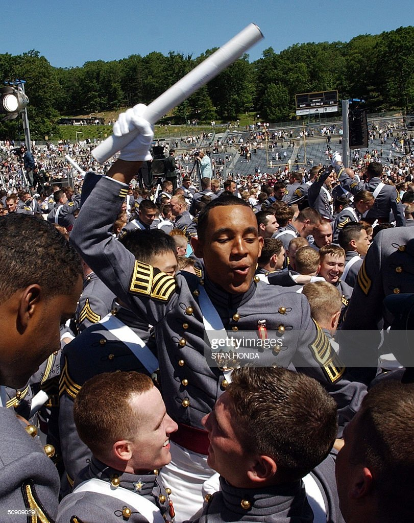 Cadets from the US Military Academy class of 2004 celebrate after their graduation ceremony 29 May 2004 at West Point, NY. US Secretary of Defense Donald Rumsfeld gave the graduation address. AFP PHOTO/Stan HONDA