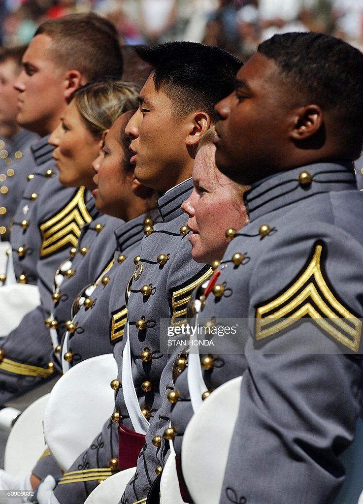Cadets from the US Military Academy class of 2004 sing the 'Alma Mater' just before the end of their graduation ceremony 29 May 2004 at West Point, NY. US Secretary of Defense Donald Rumsfeld gave the graduation address. AFP PHOTO/Stan HONDA