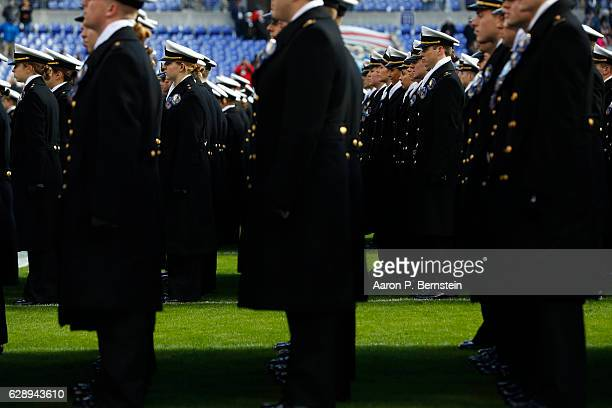 Cadets from the US Naval Academy line up on field prior to the game between the Navy Midshipmen and the Army Black Nights at MT Bank Stadium on...