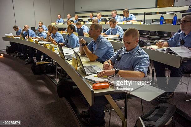 Cadets listen and take notes during a training course at the California Highway Patrol Academy in West Sacramento California US on Wednesday Oct 7...