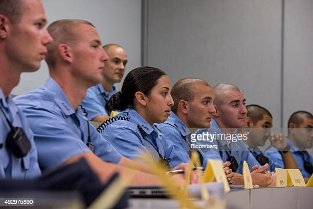 Cadets listen during a training course at the California Highway Patrol Academy in West Sacramento California US on Wednesday Oct 7 2015 California...
