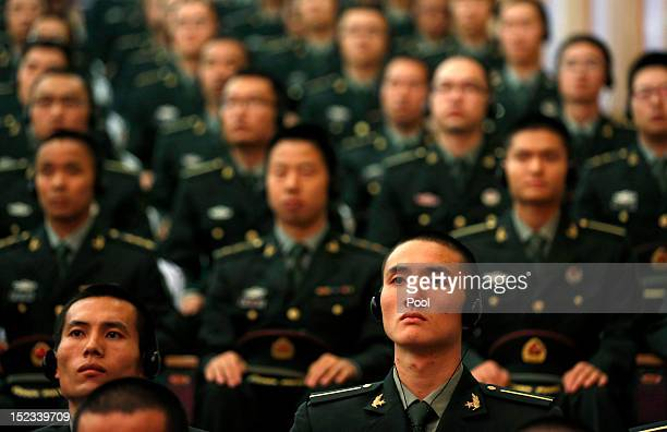 Cadets listen to US Secretary of Defense Leon Panetta address the school at the PLA Engineering Academy of Armored Forces on September 19 2012 in...