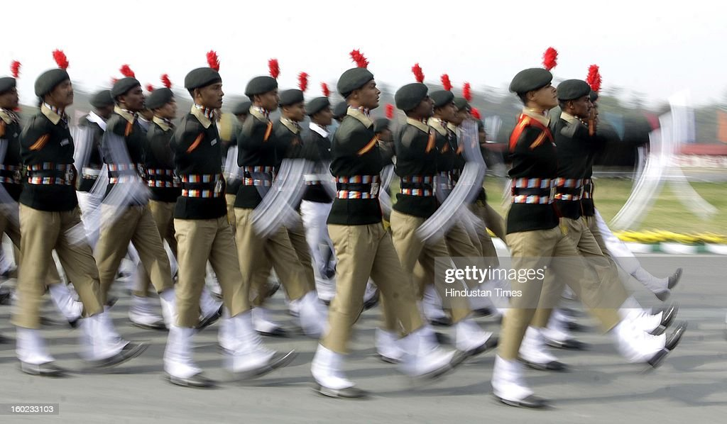NCC cadets marching towards saluting dais taken by Prime Minister Manmohan Singh during NCC PM's rally at Delhi Cantt. Parade Ground on January 28, 2013 in New Delhi, India.