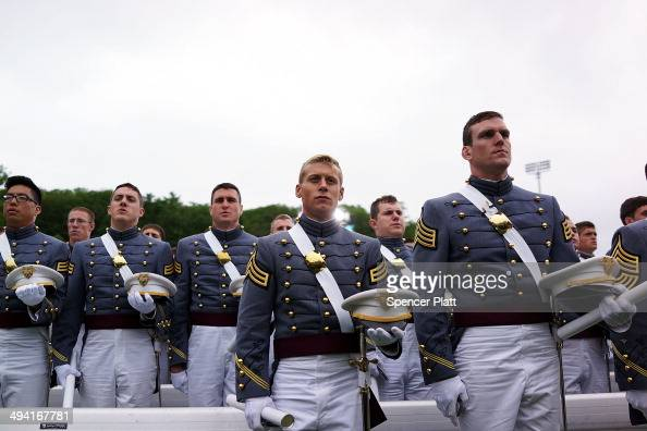 Cadets pause for the Benediction before tossing their hats into the air at the conclusion of the graduation ceremony at the US Military Academy at...