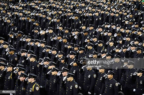 Cadets salute during the New York Police Department graduation ceremony at Madison Square Garden on December 29 2014 in New York City New York City...