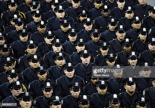 Cadets stand during the New York Police Department graduation ceremony at Madison Square Garden on December 29 2014 in New York City New York City...
