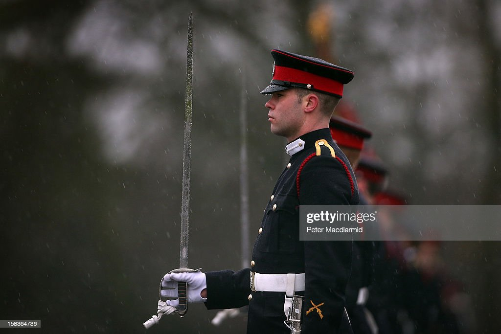 Cadets take part in the Sovereign's Parade during heavy rain at the Royal Military Academy at Sandhurst on December 14, 2012 in England. The parade marks the completion of 44 weeks of training for 200 young people who will be commissioned into the British Army and the armies of 13 overseas countries. Senior Under Officer Sarah Hunter-Choat became the fourth woman in the Royal Military Academy's history to receive the prestigious Sword of Honour which is awarded to the best Officer Cadet on the course.